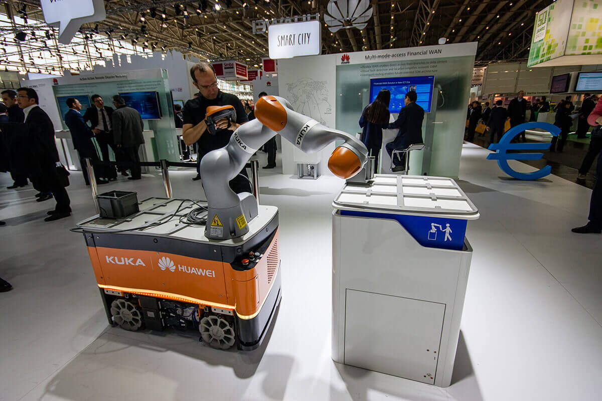 Industrial KUKA robot built by Huawei at CeBIT information technology trade show in Hannover, Germany on March 14, 2016